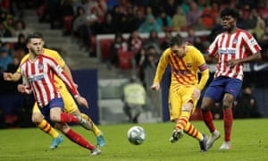 Lionel Messi scores a trademark winning goal against Atlético Madrid.
