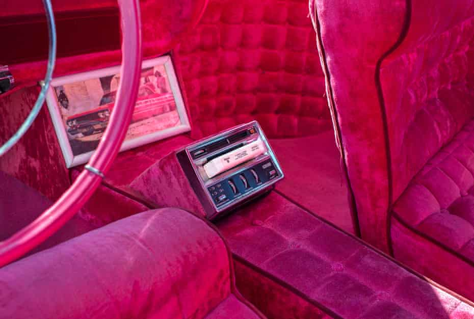 pink car interior with tape deck