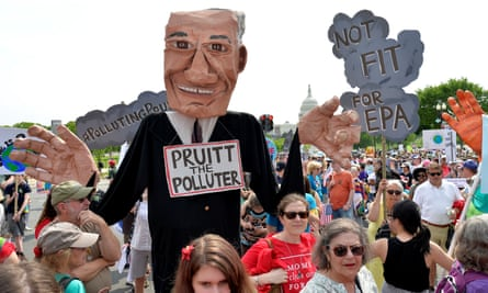 A giant puppet depicting EPA Administrator Scott Pruitt is carried among demonstrators during a People's Climate March, to protest U.S. President Donald Trump's stance on the environment, in Washington, April 29, 2017.