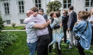 Van der Bellen supporters hug after news of his win emerges.