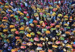 Devotees in Ahmedabad, India, take part in a procession during the religious festival of Panguni Uthiram celebrated in honour of the Hindu god Muruga