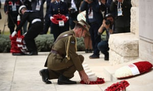 Australia's defence force chief, Angus Campbell, lays a wreath