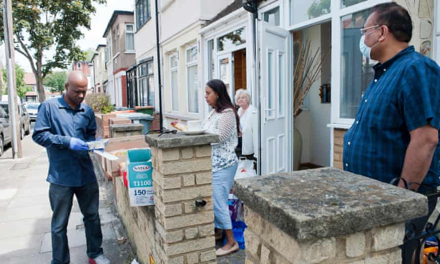 People in East Ham, London, sort out food parcels for delivery to families.