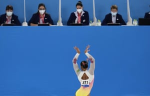 Tokyo, JapanRebeca Andrade, of Brazil, performs before a row of judges during the artistic gymnastics women's apparatus final at the 2020 Summer Olympics.