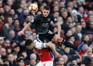 Burnley's Ashley Westwood clastters into Arsenal's Granit Xhaka.