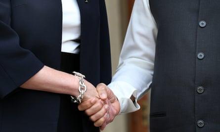 Theresa May shakes hands with PM Narendra Modi.