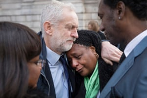 Labour Party Leader Jeremy Corbyn consoles Nyalissa Mendy after they attended St Paul's Cathedral for the Grenfell Tower National Memorial Service marking the six month anniversary of the fire. Ms Mendy is a releative of Grenfell fire victim Mary Mendy. Diane Abbott, Shadow Health Secretary (L) and family friend Damel Carayol (R) look on.