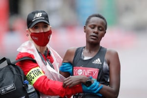 Edith Chelimo of Kenya is helped by a doctor after finishing the women's race.