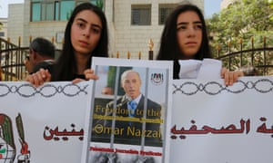 Palestinian journalists protest in support of their colleague Omar Nazzal after he was detained the previous day by Israeli forces.