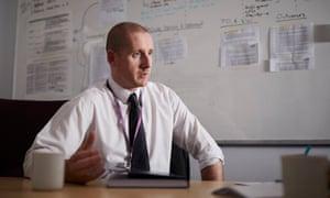 Jason Roberts at desk