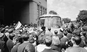 Fans crowd around the West Germany coach as the players disembark at Wembley Stadium
