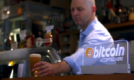 A Bitcoin sign at a pub in Sydney, Australia. Cryptocurrencies have grown in popularity in recent years.