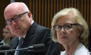 George Brandis and President of the Human Rights Commission Professor Gillian Triggs at the Senate Legal & Constitutional affairs committee in the main committee room of Parliament House on Tuesday.