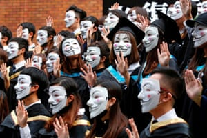 Hong Kong, China University students wearing Guy Fawkes masks in support of anti-government protests pose for a graduation photo at the Hong Kong Polytechnic University
