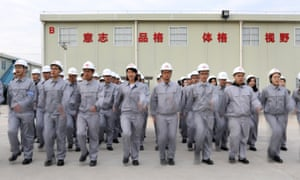 Huawei trainees in white hats and uniform