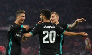 Marco Asensio, centre, is congratulated by Cristiano Ronaldo and Toni Kroos.