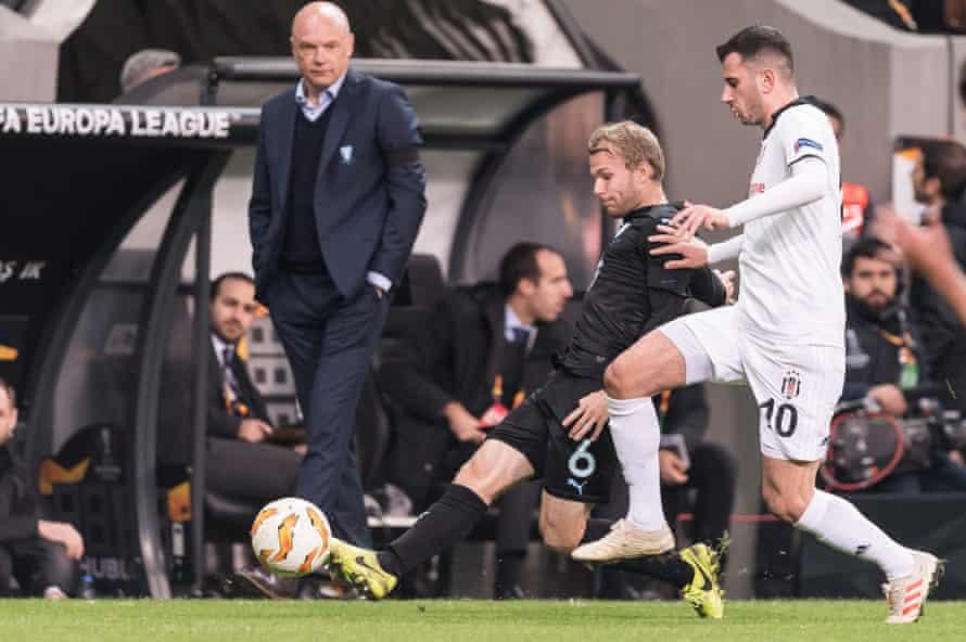 Uwe Rosler looks on as Oscar Lewicki makes a tackle on Besiktas' Oguzhan Ozyakup during Malmö's Europa League win in December.