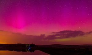 The Aurora Borealis are seen over Usk Reservoir near Brecon, south Wales