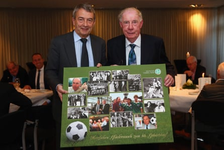 Wolfgang Niersbach, the President of the German Football Association, poses with Dietrich Weise, right, during a reception to celebrate Weise's 80th birthday in November 2014.