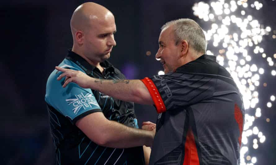 Rob Cross (left) sent Phil Taylor into retirement with defeat in the final of the 2018 PDC World Darts Championship.