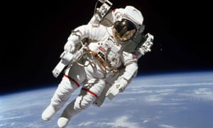 Bruce McCandless outside the Space Shuttle Challenger in 1984 as he carries out the first spacewalk in which an astronaut was allowed to float freely without attachments.