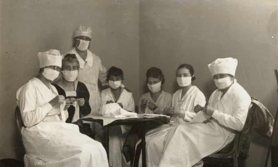 Women making face masks to combat Spanish flu