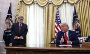 Donald Trump with William Barr at the White House in July. The DoJ is investigating an alleged 'bribery for pardon' scheme.