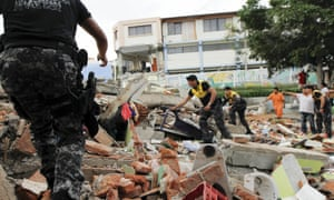 Red Cross members, military and police officers work at a collapsed area after an earthquake struck off Ecuador's Pacific coast.