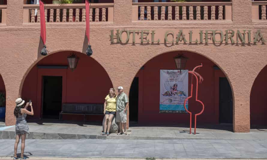 Tourists outside Hotel California in the town of Todos Santos, Mexico.