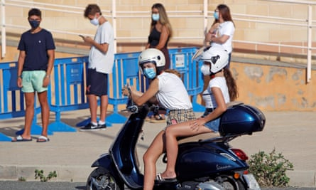 People wait to be tested for Covid-19 in the coastal town of Santa Pola in Spain afte a disco in July