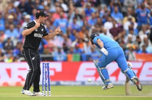 Dhoni, run out by Guptill.