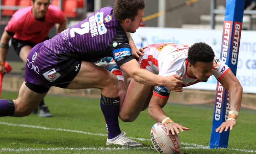 Regan Grace touches down St Helens' third try.