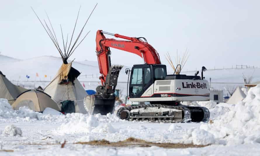 Crews remove waste from the camp opposing the Dakota Access pipeline near Cannon Ball, North Dakota.