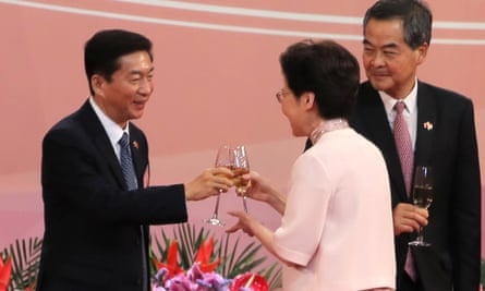 Hong Kong's chief executive Carrie Lam toasts with Luo Huining at a flag-raising ceremony marking the anniversary of the Hong Kong handover to China.