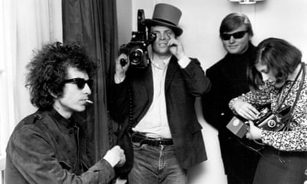 Bob Dylan with DA Pennebaker in the background filming Don't Look Back. Photo by Michael Ochs Archives/Getty Images