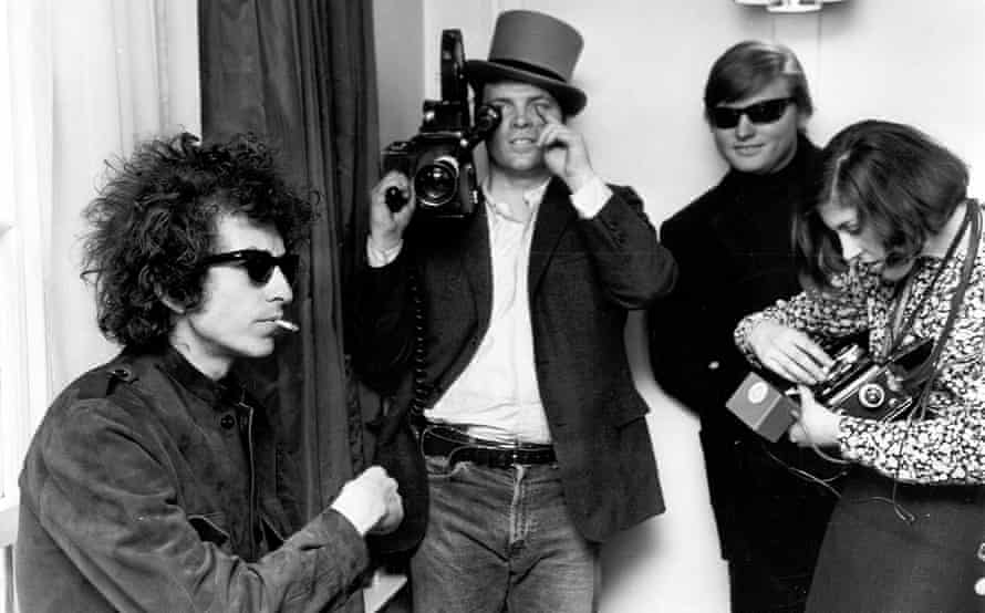 Bob Dylan on his 1966 tour of Britain. DA Pennebaker is in the background filming the documentary Don't Look Back.