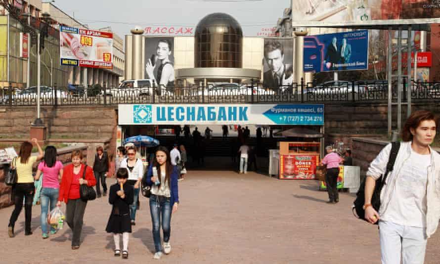 People walk along a shopping street in Almaty, Kazakhstan