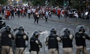 River Plate fans clash with riot police outside the Antonio Vespucio Liberti stadium.