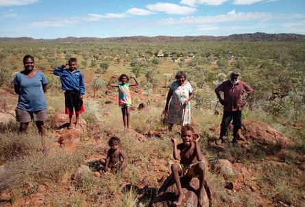 Shirley Purdie (floral dress) and her husband Gordon Barney (white beard) are voluntarily isolating with family members at Violet Valley in the east Kimberley in Western Australia.