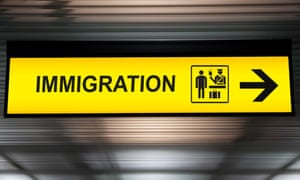 An immigration and customs sign
