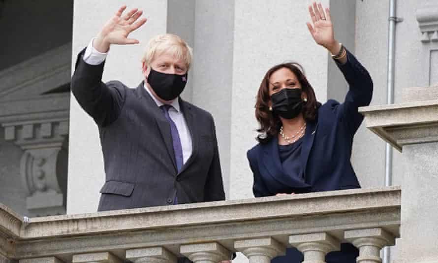 Johnson with Kamala Harris waving from a balcony