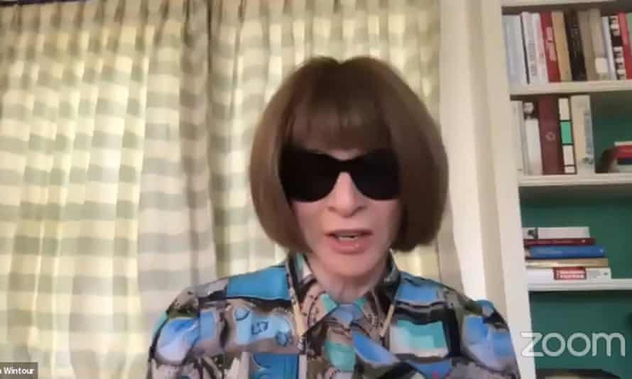 Anna Wintour with dark glasses and drawn curtains in Vogue Global Conversations.