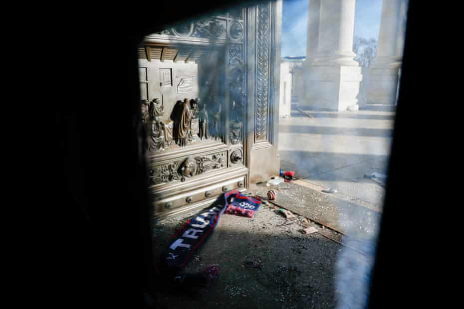 Shattered reinforced glass and debris litter the east steps in the US Capitol on 7 January.