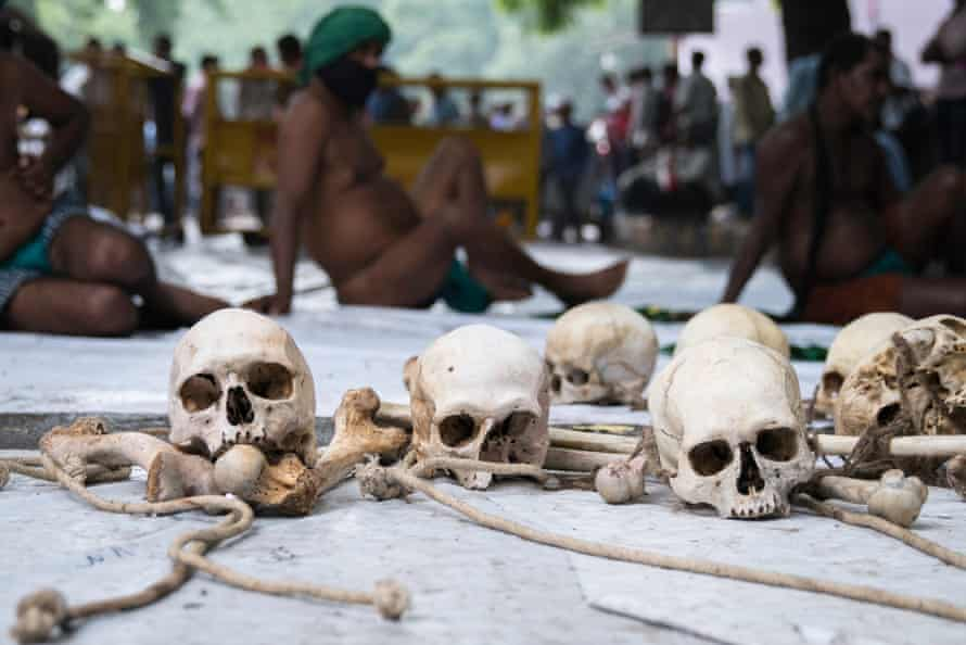 Farmers from Tami Nadu demonstrate in Delhi with what they say are the bones of farmers who committed suicide because of a crippling drought and high debt.