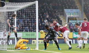 Burnley's Chris Wood scores.