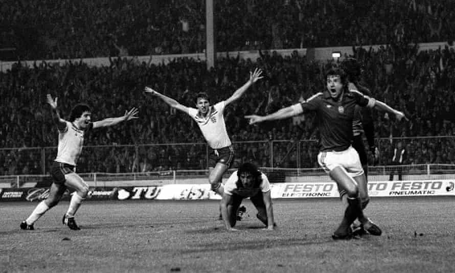 Paul Mariner on his knees, having just scored for England against Hungary in a World Cup qualifier on 18 November 1981