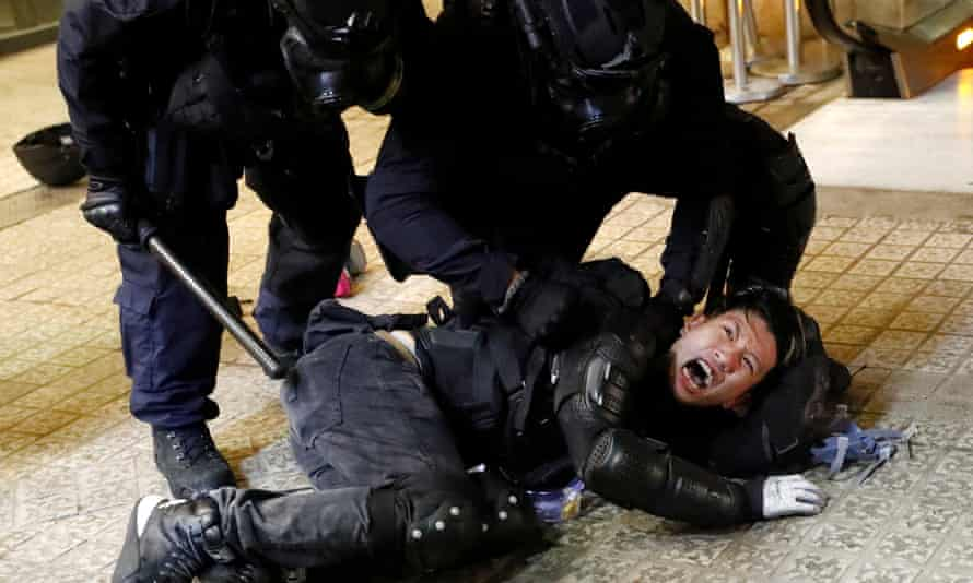Police detain a protester on Saturday
