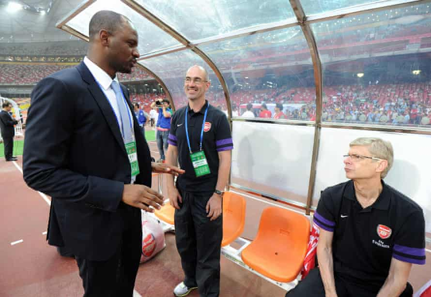 Steve Morrow (centre) with the former Arsenal player Patrick Vieira and Arsène Wenger before Arsenal's friendly against Manchester City in Beijing in July 2012.