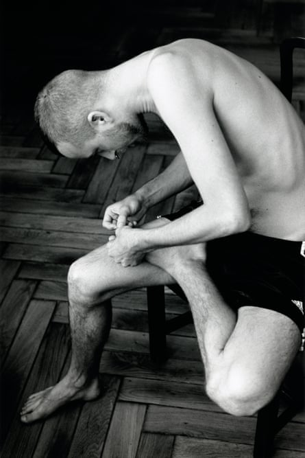 Anders pulling splinter from his foot, 2005.