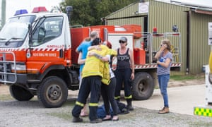 People embrace at Numeralla Rural Fire Brigade